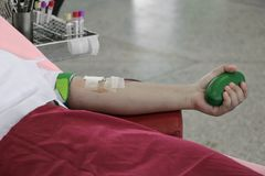 Blood donor in arm injection select focus with shallow depth of field.  Stock Photo
