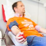 Blood donor at donation. Blood donor at donation with a bouncy ball holding in hand stock images