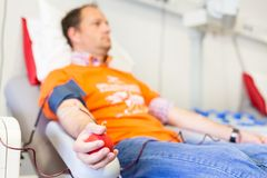 Blood donor at donation. Royalty Free Stock Image