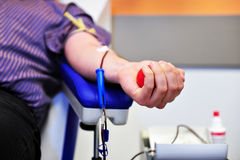 Blood donor hand. The hand of a blood donor squeezing a medical rubber ball royalty free stock photography