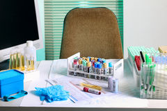 Blood drawing room. Laboratory bench with blood and urine samples royalty free stock photography