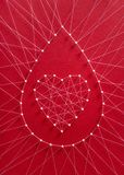 Blood drop donation concept. Donate blood concept. Network of pins and threads in the shape of a blood drop symbolising group effort and collaboration for saving royalty free stock photography