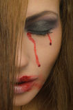 Blood from the eyes and face of woman Stock Photo