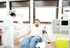 Blood giving at hospital Stock Photos