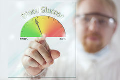 Blood Glucose Level. Physician Showing Blood Glucose Meter at Screen Royalty Free Stock Photo