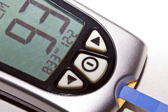 Blood glucose meter. A blood glucose meter showing normal blood sugar results royalty free stock photo