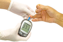 Blood glucose meter, the blood sugar value is measured on a fing Royalty Free Stock Photo