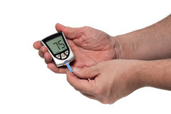 Blood glucose meter to check the blood sugar level Stock Photography