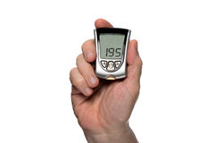 Blood glucose meter to check the blood sugar level Royalty Free Stock Images