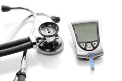 Blood glucose meter to check the blood sugar level Royalty Free Stock Image