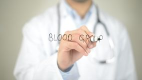 Blood Group , Doctor writing on transparent screen royalty free stock photo