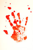 Blood hand. Bloody print of a bleeding hand on a white background Stock Image