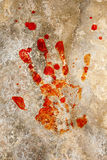 Blood hand on grunge. Grung background with a print of a blood hand Stock Photography
