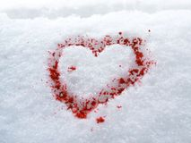 Blood heart-shape in snow Stock Photo