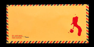 Blood on the Mail. A yellow air mail envelope with a some blood stains on it Stock Images