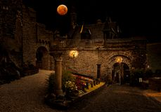 Blood moon over medieval city. Blood moon over the castle Cochem in germany stock image