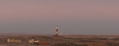 Blood Moon rising at the Luederitz Lighthouse in Diaz Point near Lüderitz, Namibia, Africa. royalty free stock photos
