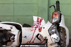 Blood motorcycle mudguard. Close up the front mudguard white blur motorcycle with blood and broken headlights of an accident Stock Photos