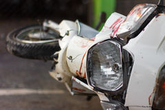 Blood motorcycle mudguard. Close up the front mudguard white blur motorcycle with blood and broken headlights of an accident Stock Photography