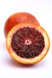 Blood Orange. Isolated Image of one blood orange leaning against one whole blood orange Royalty Free Stock Photography