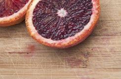 Blood Orange on Cutting Board Royalty Free Stock Images