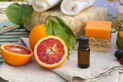 Blood orange essential oil. A dropper bottle of blood orange essential oil. Spa products in the background Royalty Free Stock Images