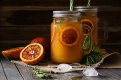 Blood orange juice with ice and orange slice royalty free stock photos