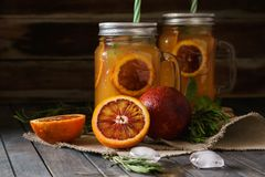 Blood orange juice in a mason jar with ice. Cold summer beverage royalty free stock photo