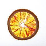 Blood orange slice. A back-lit slice of fresh blood orange royalty free stock photos