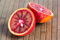 Blood orange on a wooden striped background Royalty Free Stock Photos