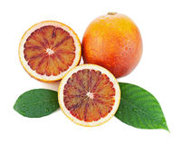 Blood oranges with cut and green leaves isolated on white backgr Royalty Free Stock Photos