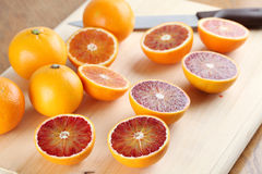 Blood oranges on cutting board Stock Images