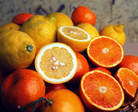 Blood Oranges and Lemons. Food StillLife. Food Art. Basket overflowing with lemons and oranges from southern Italy stock photos