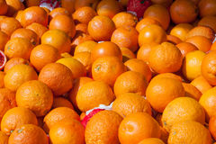 Blood oranges on market stand as background Stock Images