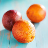 Blood oranges on rustic painted table Royalty Free Stock Images