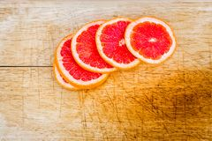 Blood oranges sliced on a wooden table royalty free stock photos