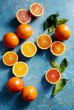 Blood oranges, whole and sliced Royalty Free Stock Images