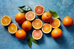 Blood oranges, whole and sliced Royalty Free Stock Image