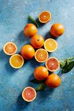 Blood oranges, whole and sliced Royalty Free Stock Photo