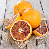 Blood Oranges on wood Stock Images