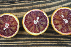 Blood oranges on a wooden background. Top view. Selective focus Stock Images