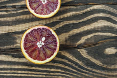 Blood oranges on a wooden background. Top view. Selective focus Royalty Free Stock Photography