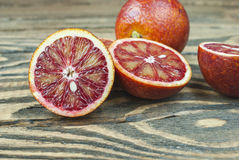 Blood oranges on a wooden background. Top view. Selective focus Royalty Free Stock Photo