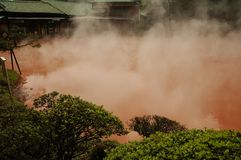 Blood pond hell - colored hot spring. Blood pond hell (chinoike jigoku), a hot spring with intensive red color in Beppu, Japan stock images