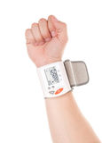 Blood pressure. Man's hand with modern digital blood pressure measurement equipment isolated on a white background stock photo