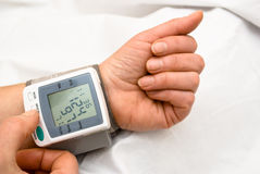 Blood pressure. Process of blood pressure examination Stock Photos