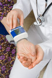 Blood pressure. The doctor measure the old woman's blood pressure Stock Photography