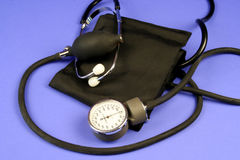 Blood Pressure Cuff. And sphygmomanometer on a blue background Stock Photography