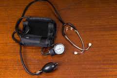 Blood Pressure Cuff and Stethoscope on Table Royalty Free Stock Photography