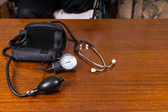 Blood Pressure Cuff and Stethoscope on Table Royalty Free Stock Images